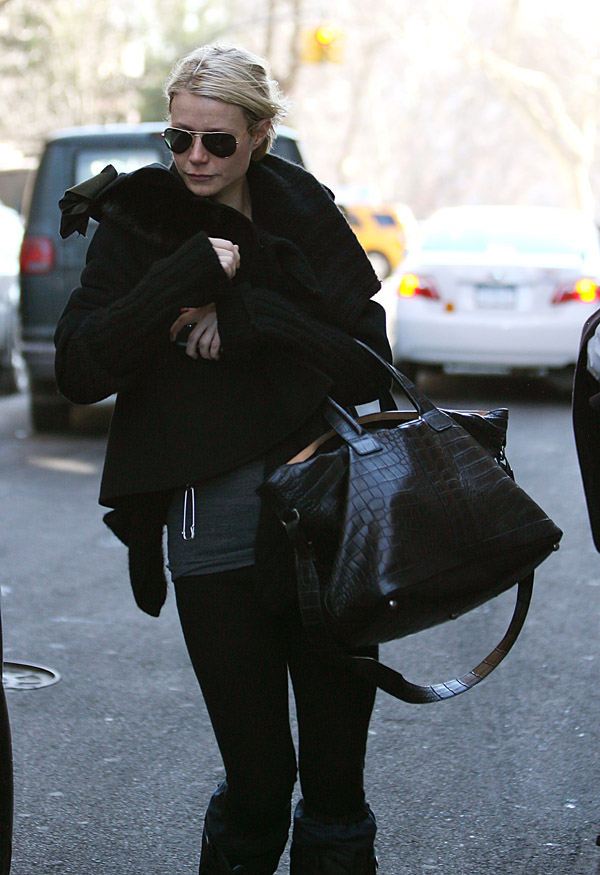 Gwyneth Paltrow wraps up against the cold as she leaves Madonna'