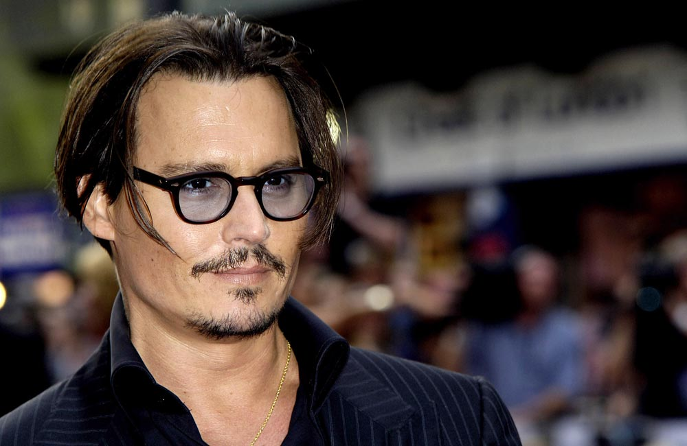 Johnny Depp says he quit smoking 2 and a half years ago. wenn2481479