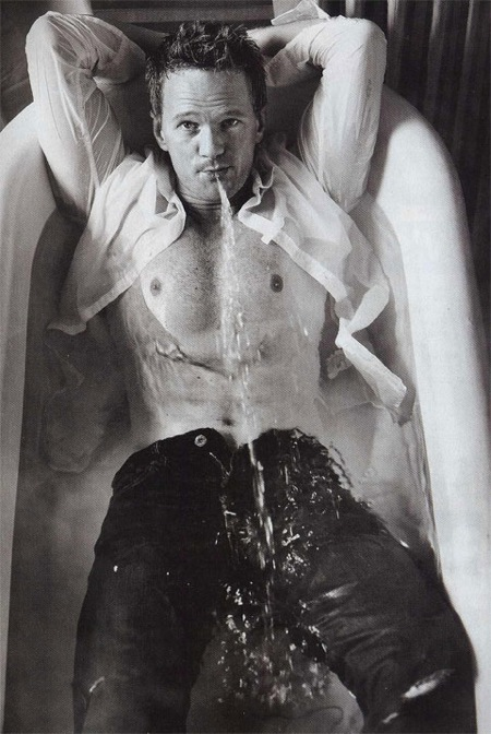 NPH taking a bath in his clothes
