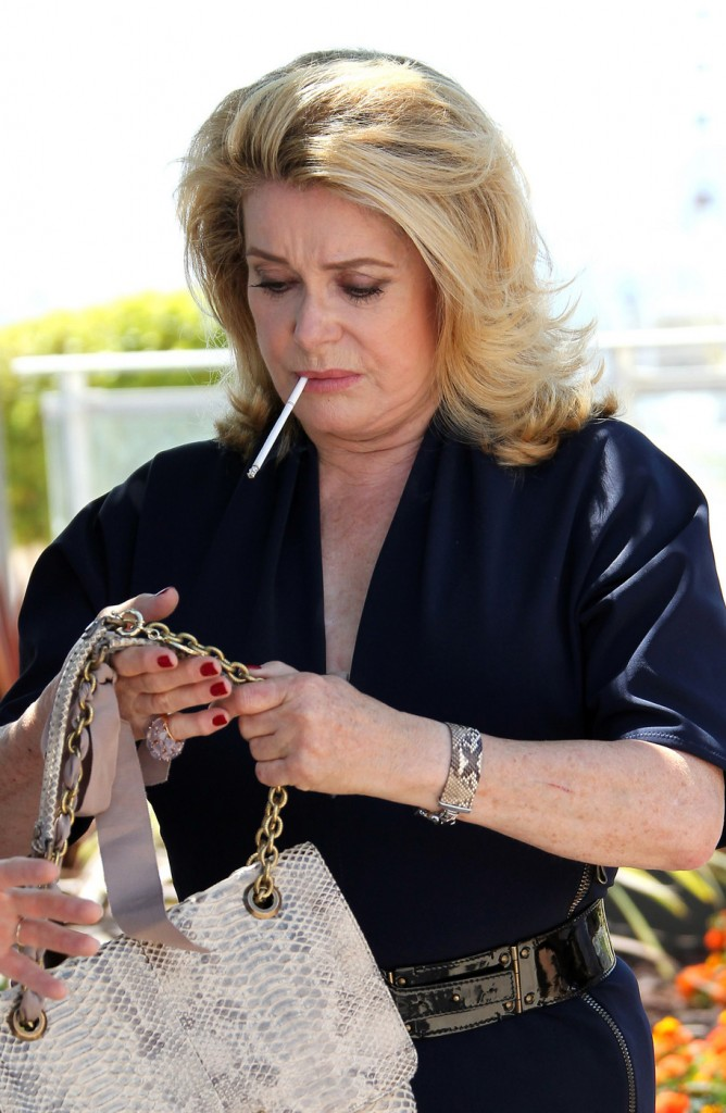Cele Bitchy Catherine Deneuve Lights Up A Cigarette At A