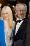Dakota Fanning and Steven Spielberg attend the 2012 White House Correspondents Association Dinner in Washington, D.C.
