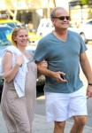Expecting parents Kelsey Grammer and wife Kayte Walsh, pregnant with twins, look to be in high spirits as the couple stroll arm in arm in New York C
