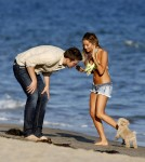 Ashley Tisdale celebrates her birthday by playing with her pooch and kissing her boyfriend Scott Speer on the beach in Malibu