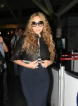 """American Idol"" judge Mariah Carey arriving at JFK Airport, New York, wearing a cute cropped leather jacket"