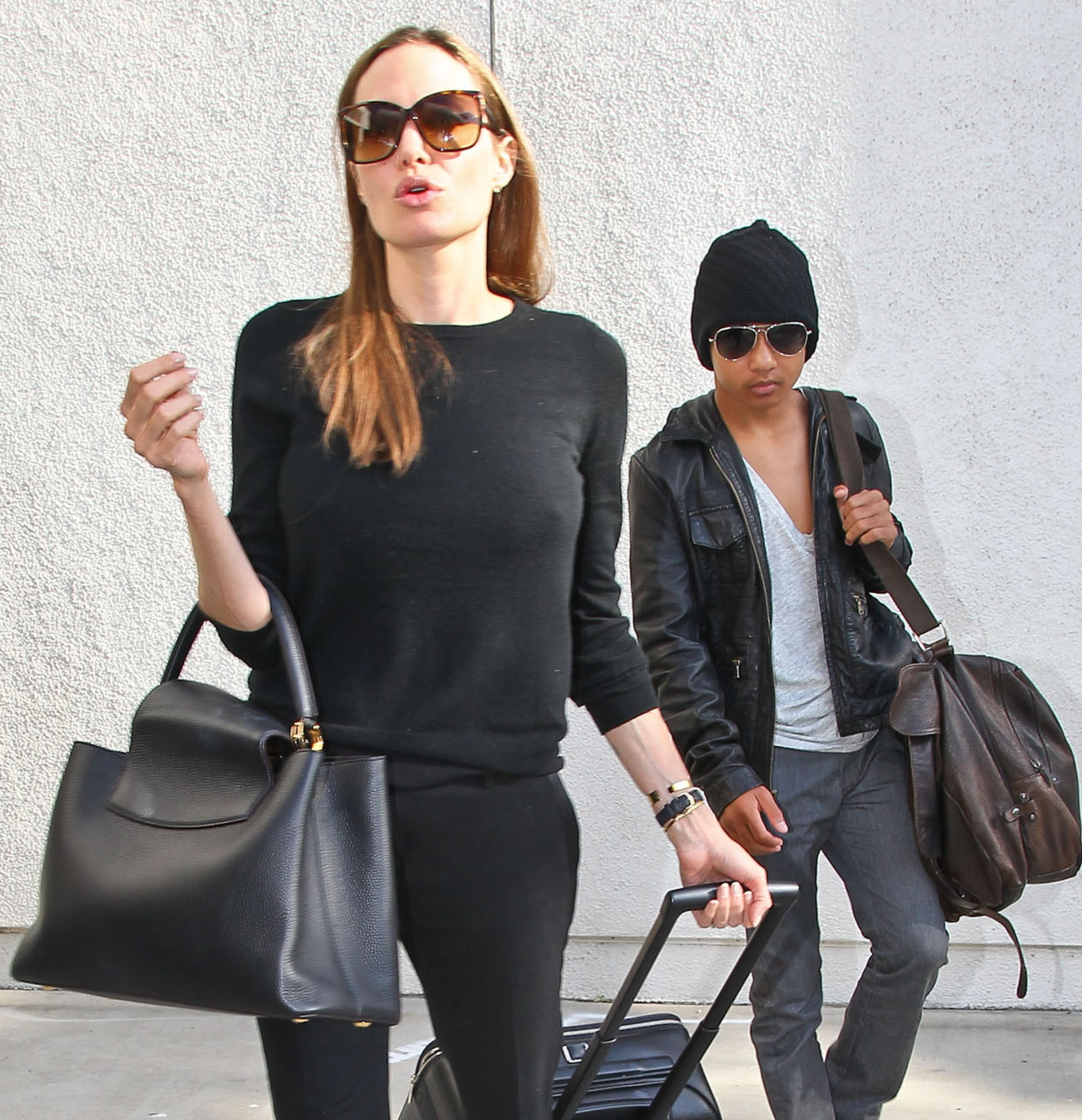 Cele|bitchy | Angelina Jolie is actually on-trend with $4700 Louis ...