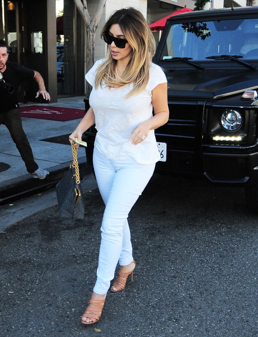 Cele|bitchy | Kim Kardashian looks exhausted, wears white skinny ...
