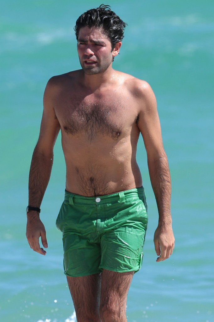 Adrian Grenier goes a shirtless dip while on the beach with his girlfriend in Miami