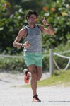 Adrian Grenier goes out for a rigorous jog on the beach in Miami