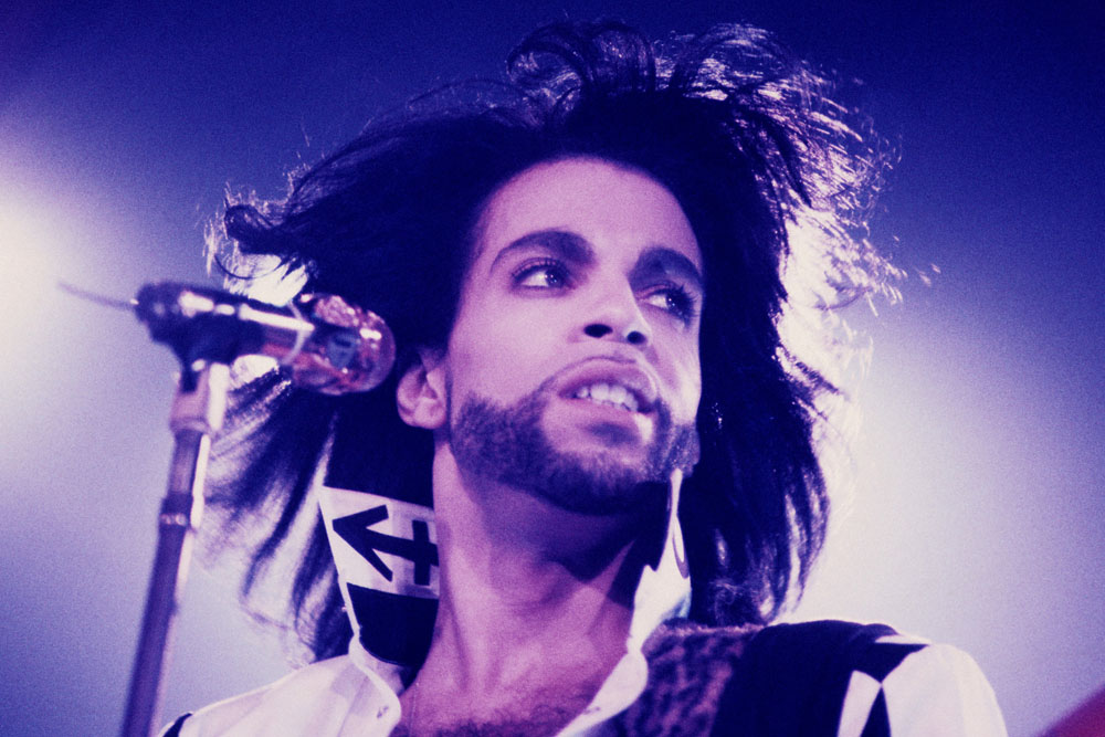 Prince performing in concert of NUDE-TOUR
