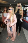 RHOA star Kim Zolciak spotted catching a flight out of LAX with her husband Kroy and kids Kroy Jr., Brielle, and Ariana