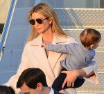 Jared Kushner and his wife Ivanka Trump walk off Air Force One with their children at Palm Beach International airport