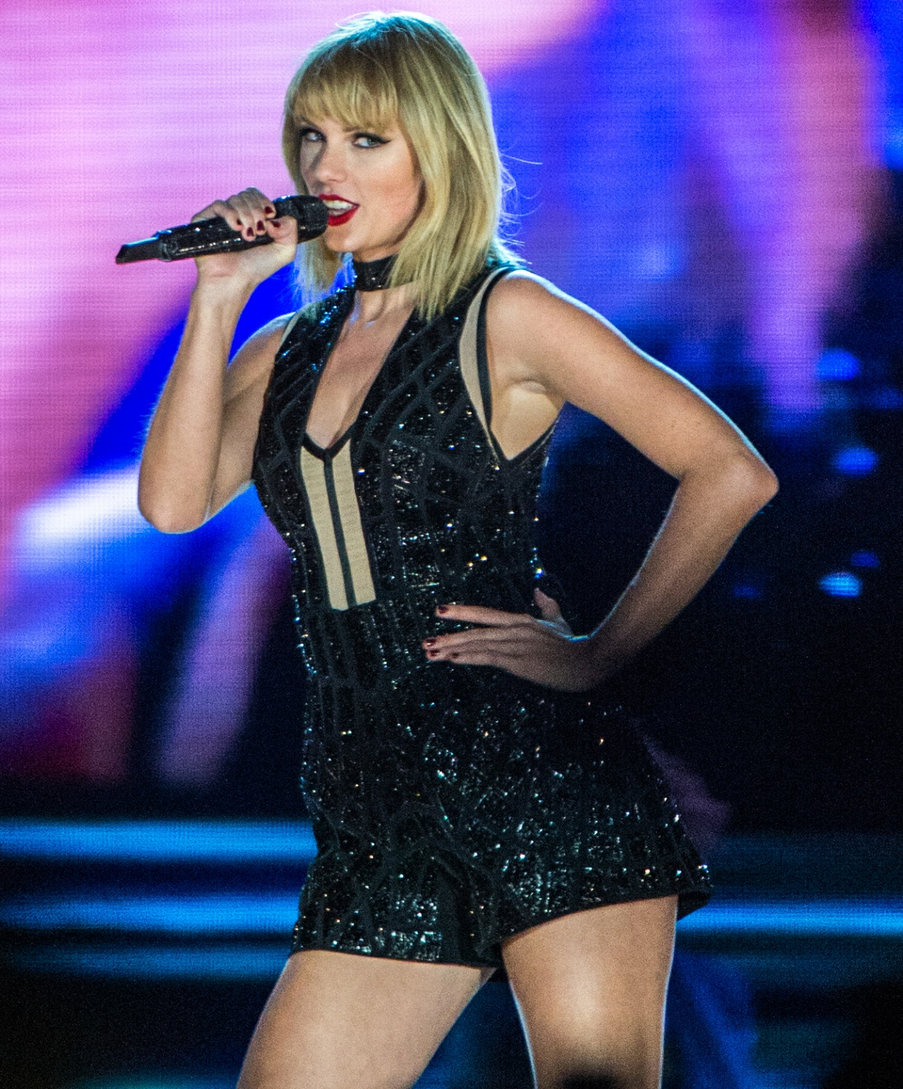 Taylor Swift performing live on stage