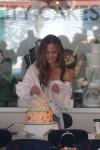 Chrissy Teigen prepares her daughter's birthday cake