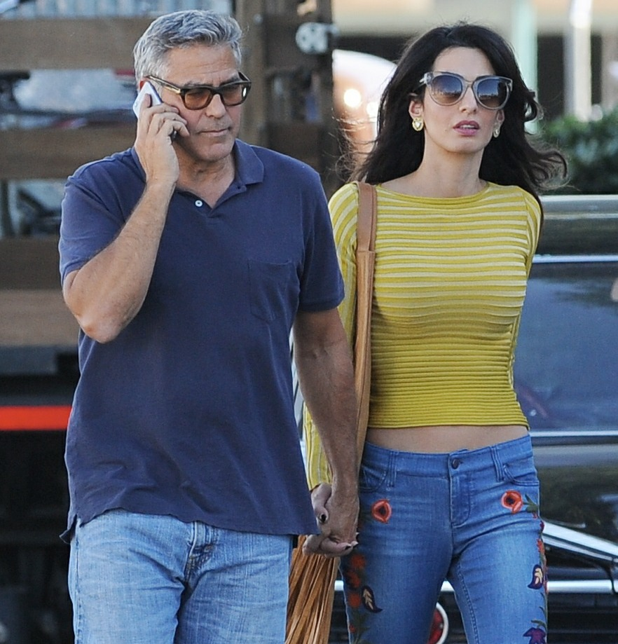 George Clooney and his wife Amal Alamuddin take their hound dog for a walk on the set of 'Suburbicon'