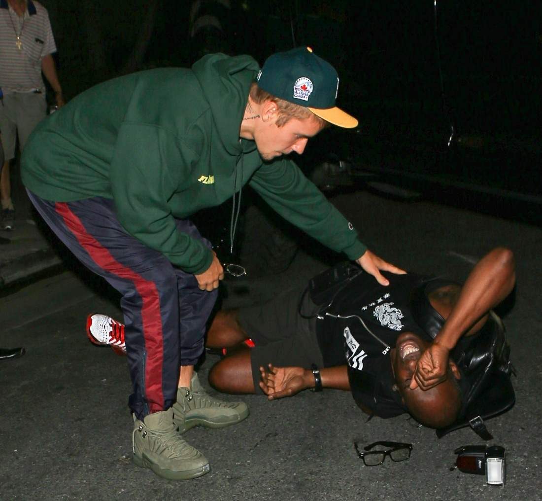Justin Bieber backed into a paparazzo last night as he left a church event