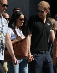 Meghan Markle and Prince Harry hold hands at the Invictus Games 2017