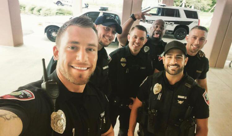 celebitchy hunky florida cops to pose for calendar after post goes viral update puppies
