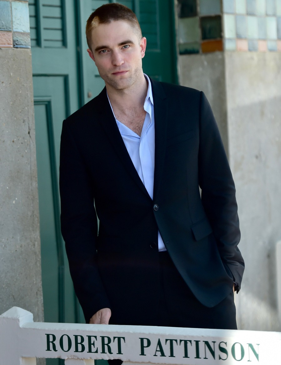 Robert Pattinson poses in front of his dedicated beach locker room during the 43rd Deauville American Film Festival