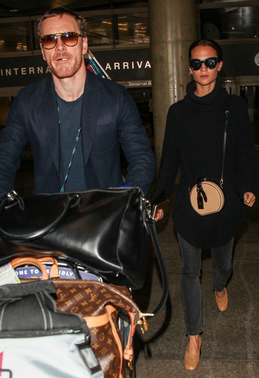 Alicia Vikander and Michael Fassbender touch down at LAX together