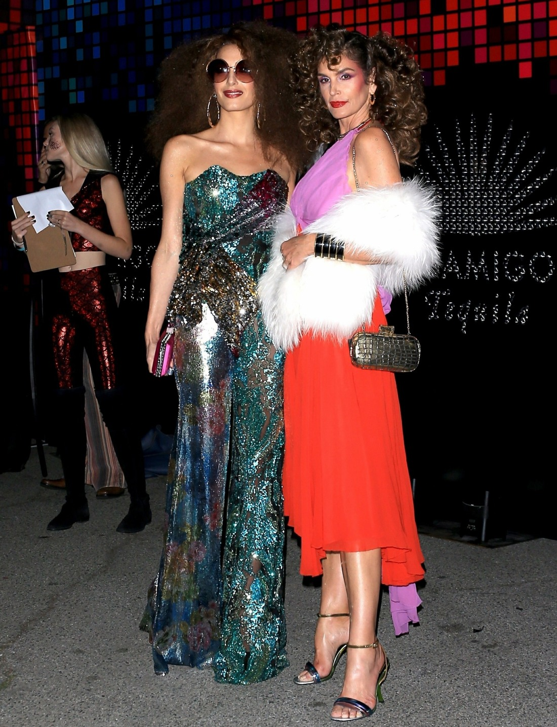 Amal Clooney and Cindy Crawford rewind the clock to the 70's at the Casamigos Event