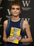 Cara Delevingne signs copies of her debut novel 'Mirror Mirror'