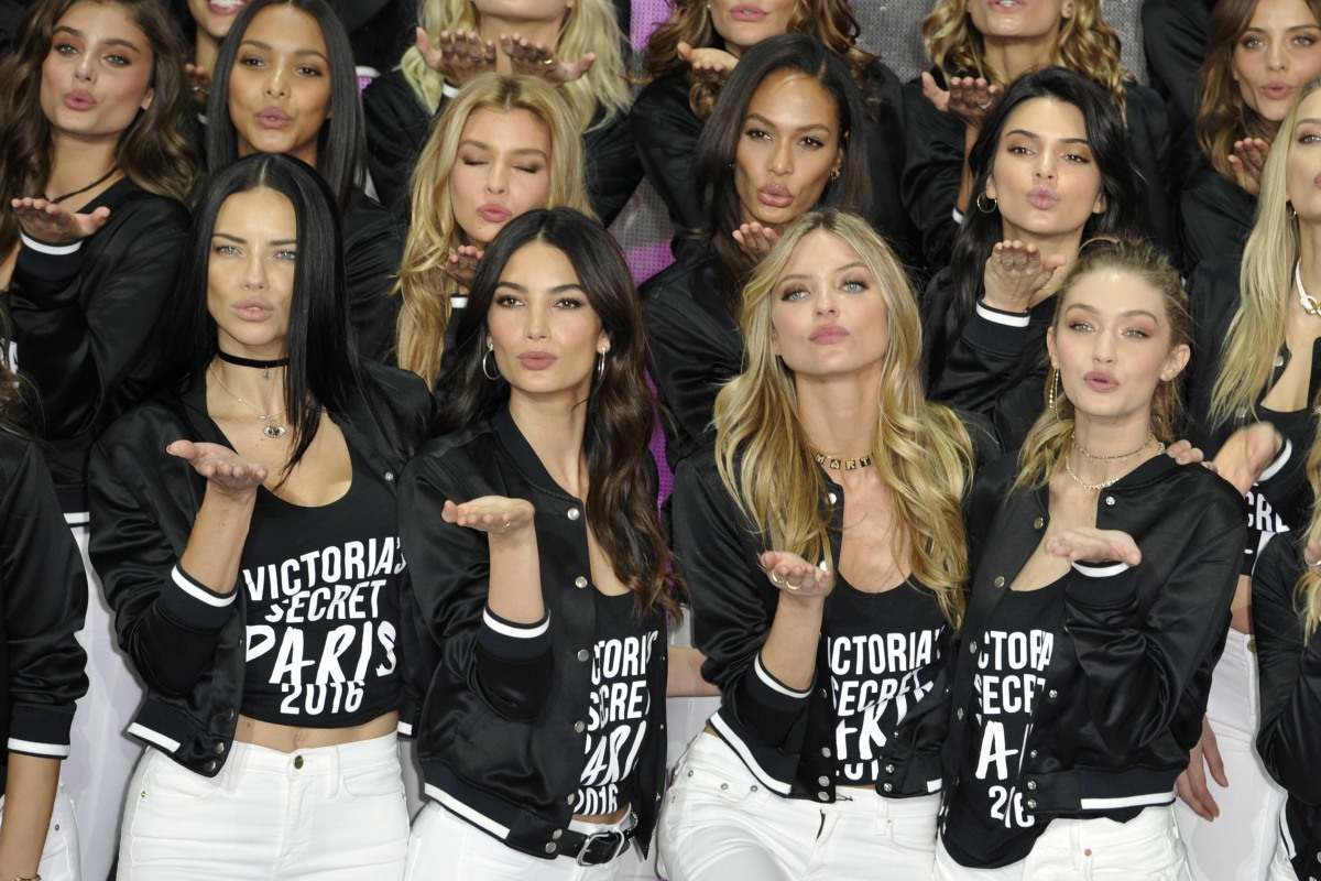Victoria's Secret models pose during a photocall at the Grand Palais