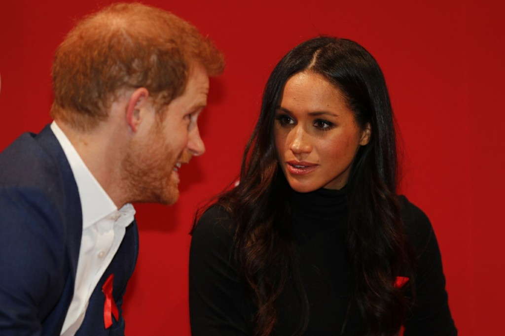 Britain's Prince Harry and his fiancee US actress Meghan Markle gesture as they tour the Terrence Higgins Trust World AIDS Day charity fair at Nottingham Contemporary in Nottingham.