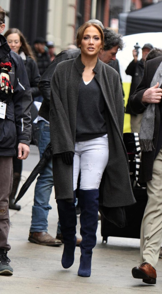 Jennifer Lopez leaves a building carrying her luggage while filming scenes with Treat Williams at the Second Act movie set in Downtown, Manhattan