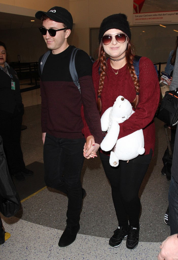 Meghan Trainor arrives at LAX with her boyfriend