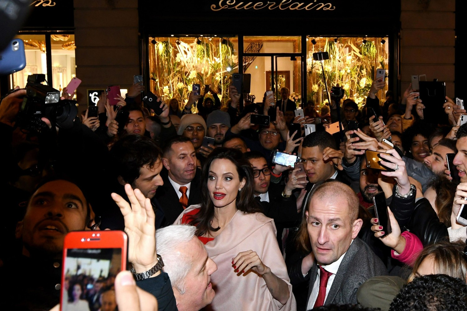 Angelina Jolie gets surrounded by fans as she leaves the Guerlain HQ
