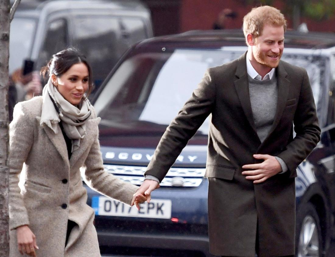 Prince Harry and fiancé Meghan Markle visit Reprezent 107.3FM in Brixton