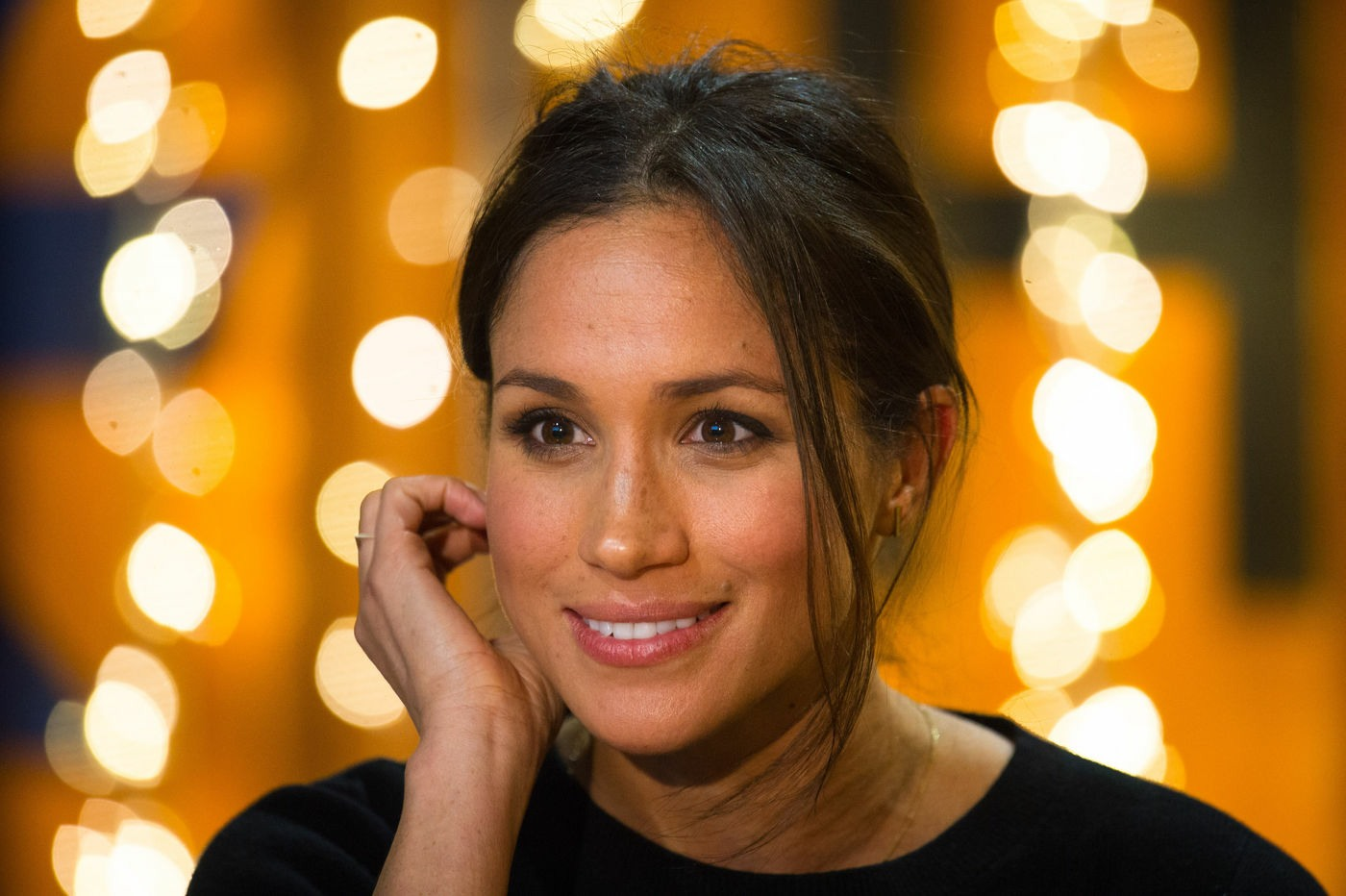 Meghan Markle during a visit to youth-orientated radio station, Reprezent FM, in Brixton, south London to learn about its work supporting young people