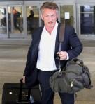 Sean Penn looks dapper arriving to LAX