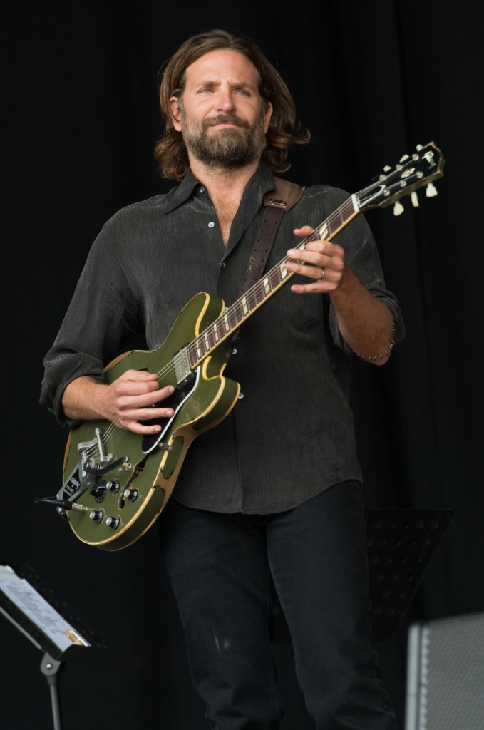 Bradley Cooper makes a surprise appearance on the Pyramid stage to shoot scenes for his film A Star Is Born at Glastonbury Festival