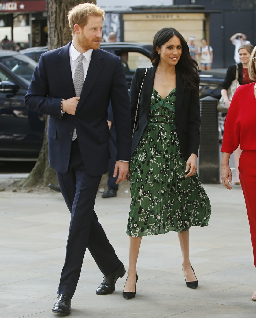 Britain's Prince Harry and Meghan Markle arrive to attend a reception hosted by Malcolm Turnbull, Prime Minister of Australia, right, and his wife Lucy Turnbull, second right, at Australia House in London celebrating the forthcoming Invictus Games Sydney 2