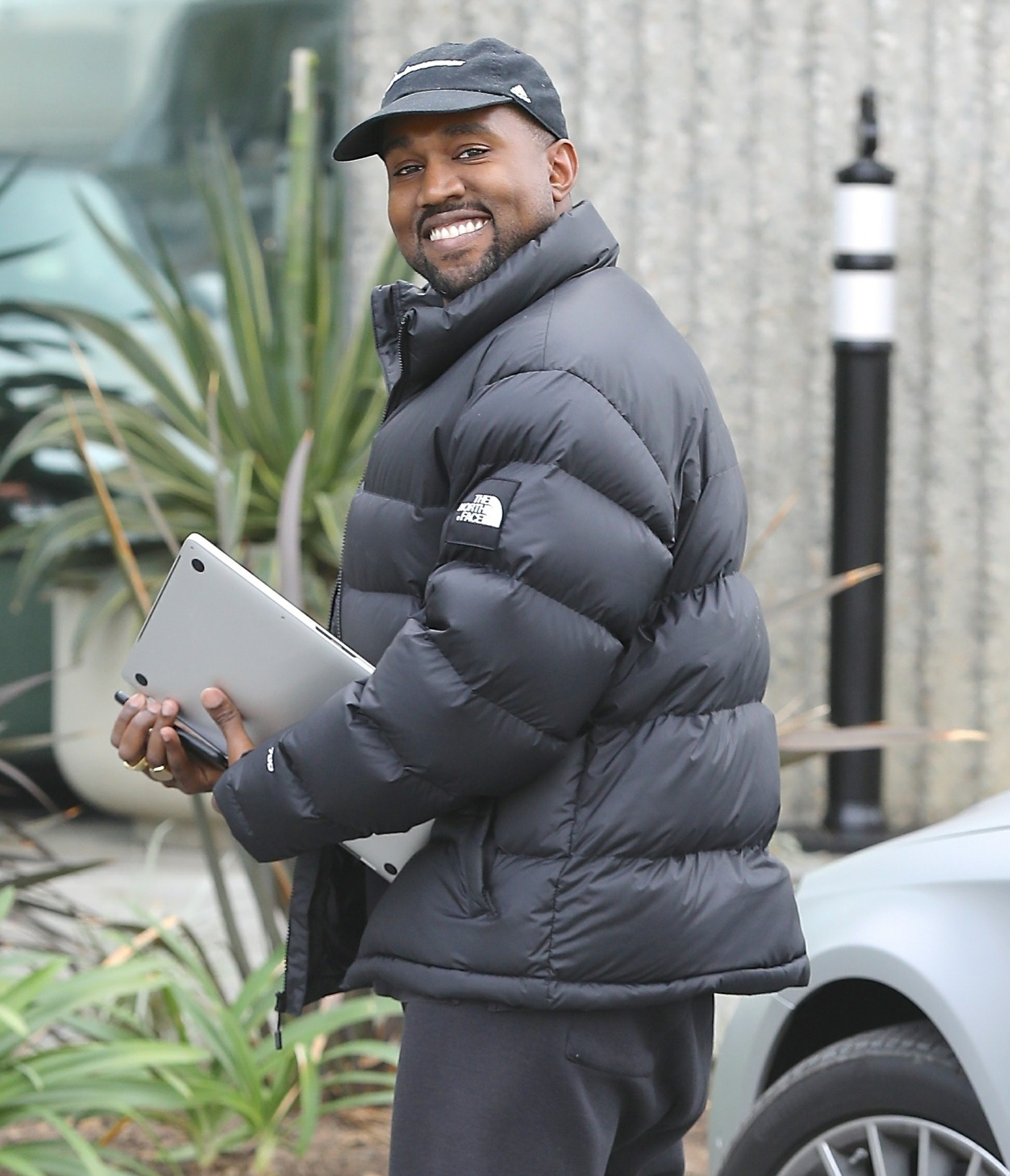 Happy Daddy Kanye West heads to work after baby number 3