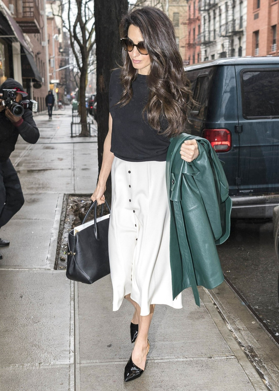 Amal Clooney returns home after teaching at Columbia Law School