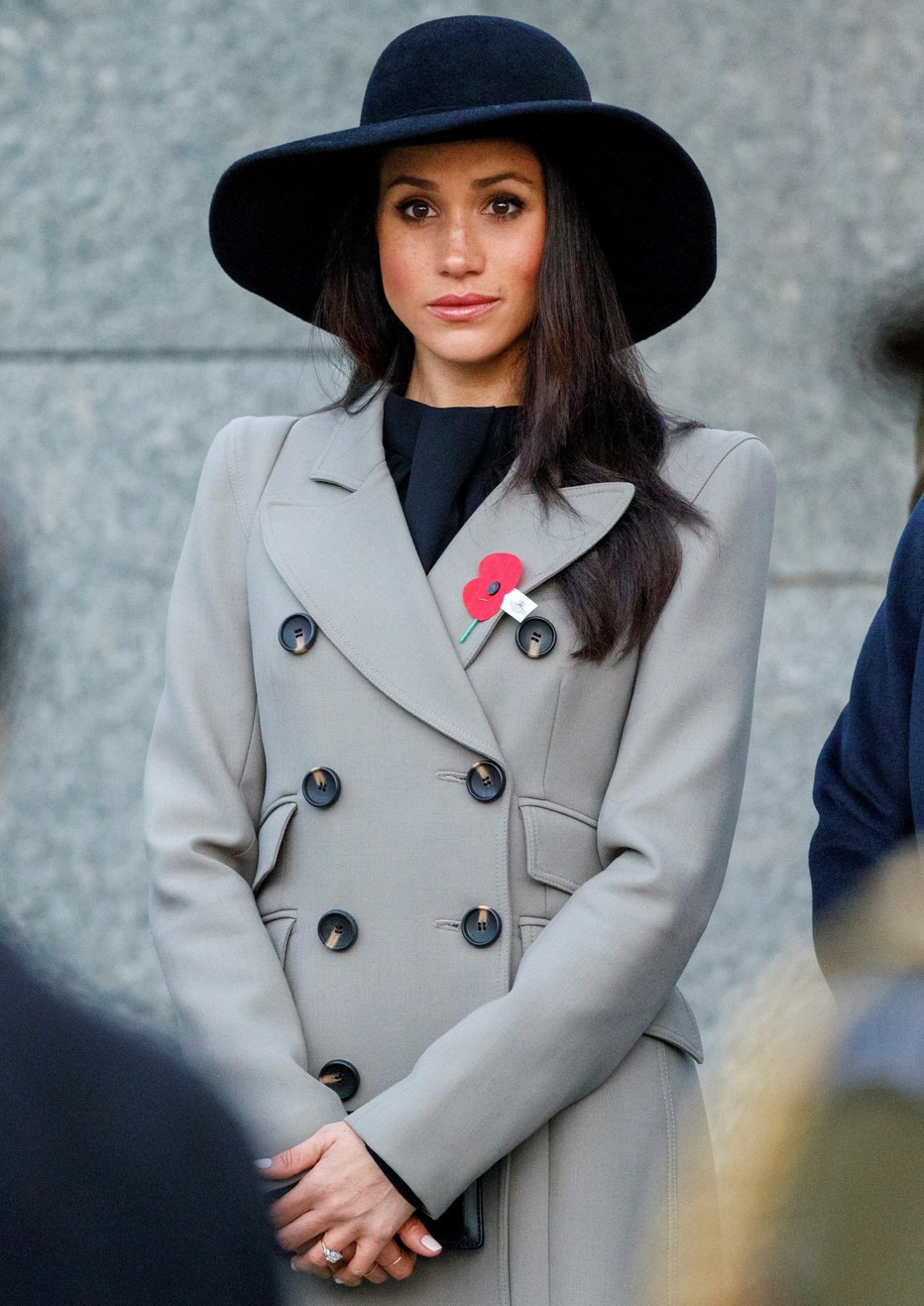 Meghan Markle looks on as Prince Harry lays a wreath at the Australian War Memorial at Hyde Park Corner to commemorate Anzac Day