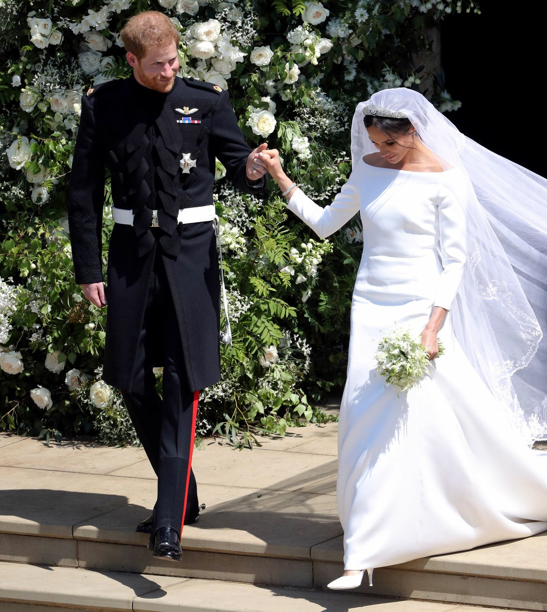 Prince Harry and Meghan Markle leave St George's Chapel in Windsor Castle after their wedding