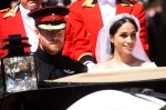 Meghan Markle and Prince Harry ride in an Ascot Landau carriage through Windsor after their wedding