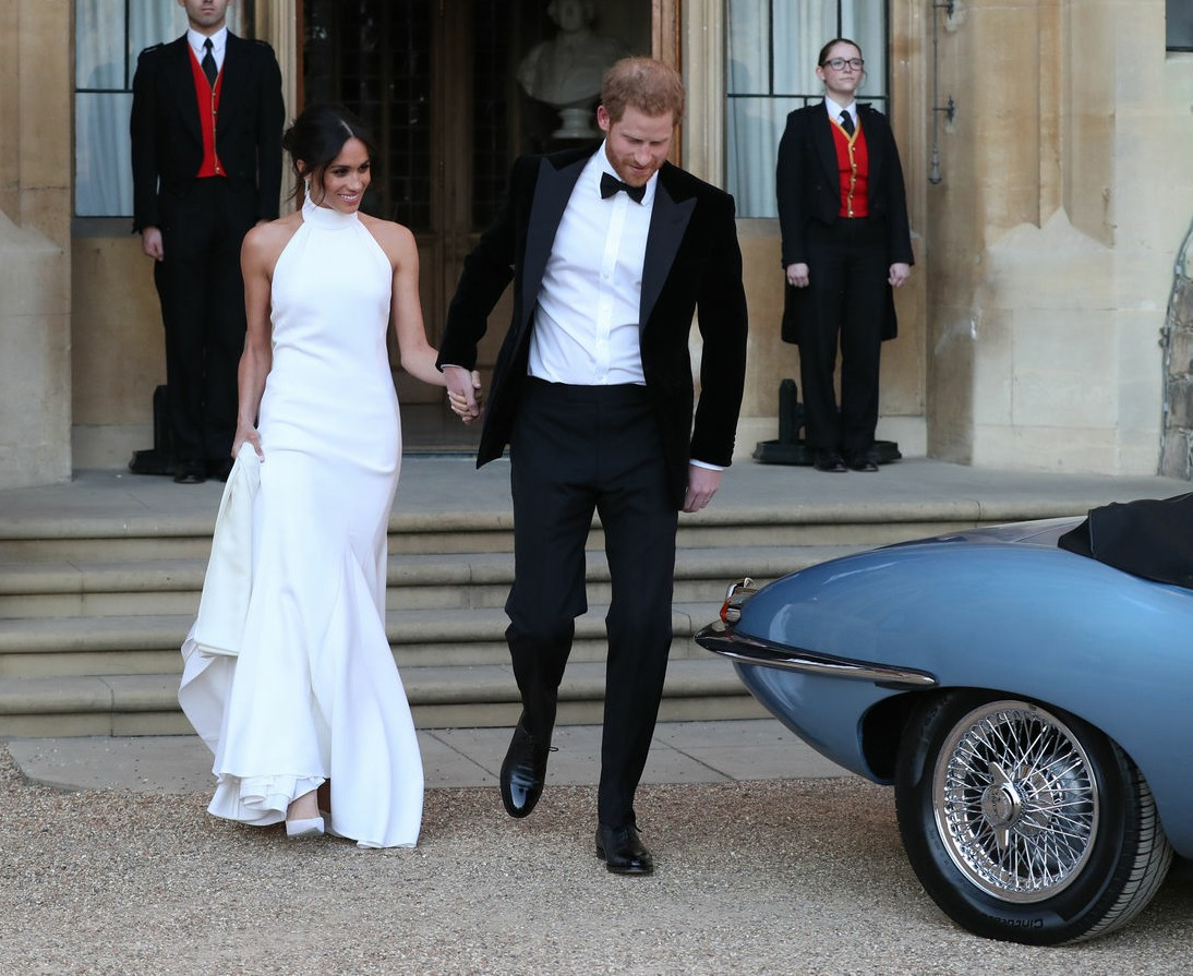 The newly married Duke and Duchess of Sussex, Meghan Markle and Prince Harry, leaving Windsor Castle after their wedding to attend an evening reception at Frogmore House, hosted by the Prince of Wales