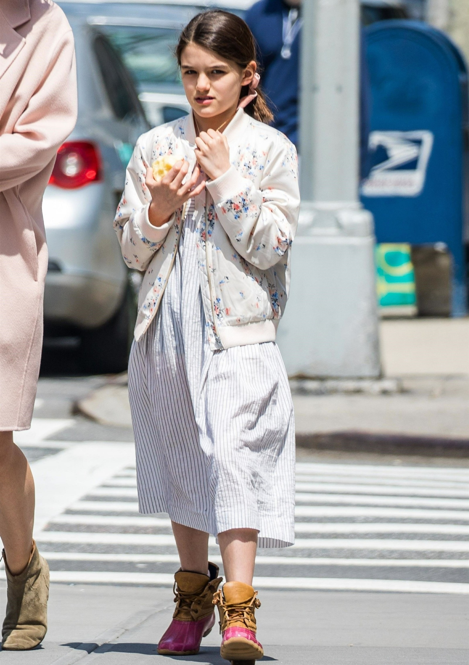 Katie Holmes and Suri Cruise sport light spring colors while strolling in Manhattan