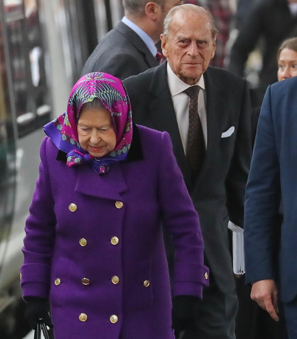 Queen Elizabeth II, accompanied by Prince Philip, arrives at King's Lynn train station