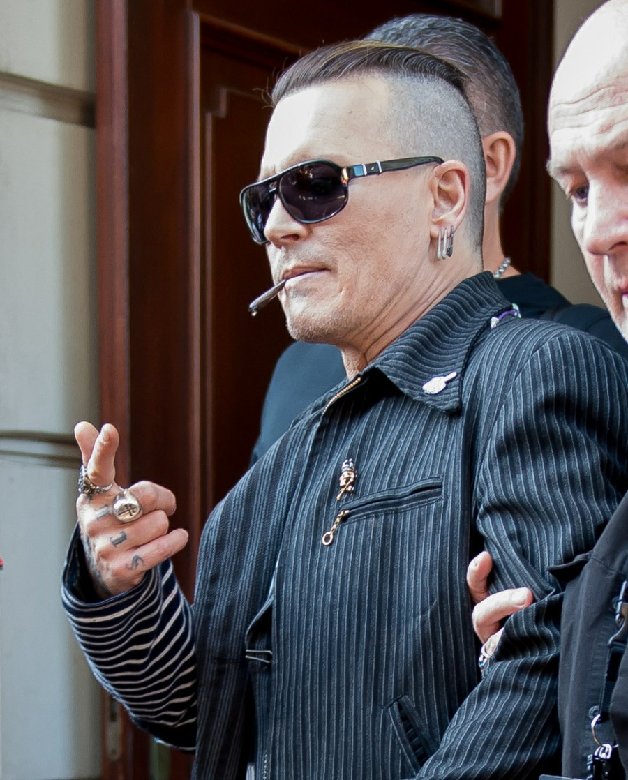 Johnny Depp leaves his hotel smoking a cigarette in Warsaw